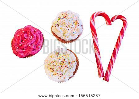 Homemade cup cakes and candy canes isolated on white background