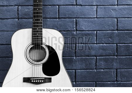 Music Guitar on brick wall background poster