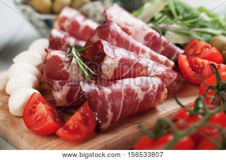 Slices of capocollo or capicola, italian cured and aged pork meat