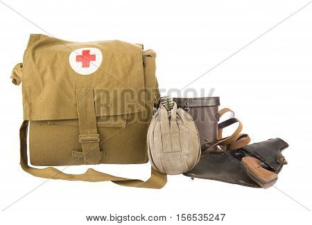 MOSCOW - NOVEMBER 12, 2016. War concept. Military flask first aid kit and handgun on holster isolated on white background.
