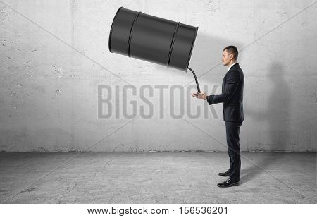 Oil flowing out of the barrel to businessman's hands, who stands in profile. Oil theft. Obtaining personal gain. Receive benefits. Oil and gas. Use of natural resources.