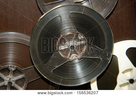 Old rare reel to tape recorder. Vintage bobine with the music. Nineteenth - twentieth century - most popular medium of recorded music. Historical analog media sound information for gramophones.