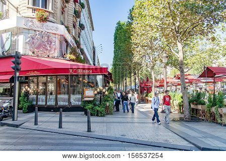 PARIS, FRANCE- circa aril 2016: Typical Parisian restaurant called l'alsace on the Champs Elysees.