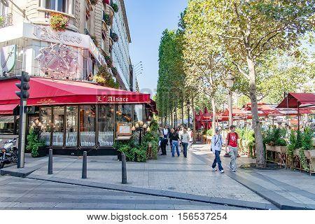 PARIS, FRANCE- circa aril 2016: Typical Parisian restaurant called l'alsace on the Champs Elysees.
