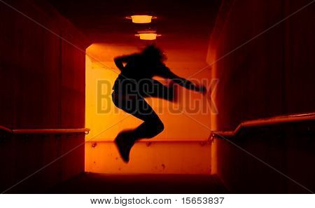 Punk Rocker jumping in tunnel