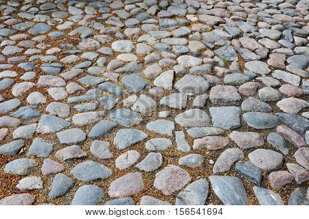 old city road of colored granite stones