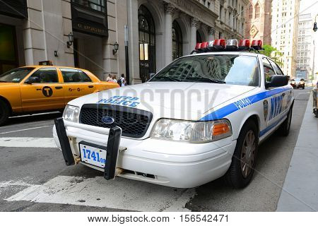 NEW YORK CITY - MAY 26, 2014: Ford Crown Victoria Police Car on 6th Avenue in Manhattan, New York City, USA