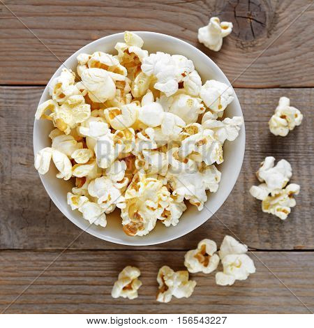Popcorn close-up on wooden table top view