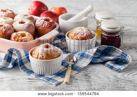 Baked Apples Baking In Oven. Fresh Apples For Baking On Board. Caramel Sauce For Baked Apples, Red B