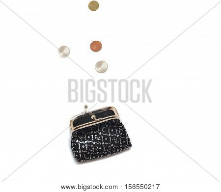 Open purse with coins falling on white background isolated