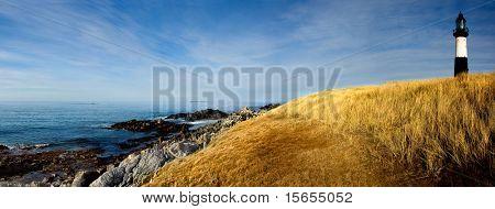 Lighthouse looks over rocky coastline in the Falkland Islands
