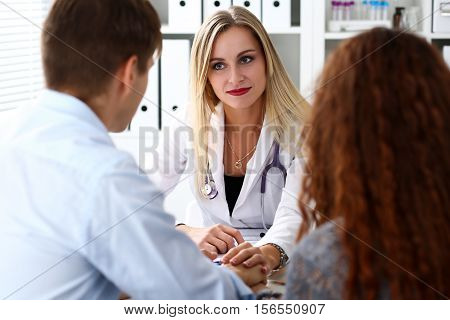 Friendly Female Doctor Hold Patient Hand