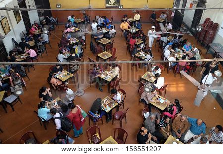 KOLKATA, INDIA - FEBRUARY 11: Visitors of popular Indian Coffee House have lunch in Kolkata on February 11,2016. The India Coffee House chain was started by the Coffee Cess Committee in 1936 in Bombay