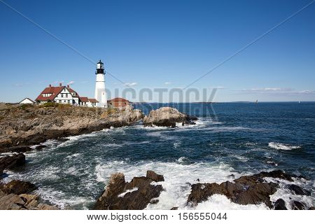 Portland Head Lighthouse operated by the United States Coast Guard has guided shipping around Cape Elizabeth Maine USA since 1791 and is on the National Register of Historic Places.
