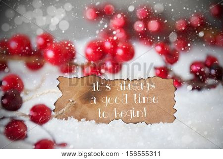 Burnt Label With English Quote It Is Always A Good Time To Begin. Red Christmas Decoration On Snow. Cement Wall As Background With Bokeh Effect And Snowflakes. Card For Seasons Greetings