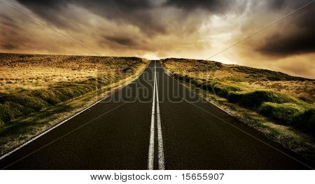 Long straight road at sunset