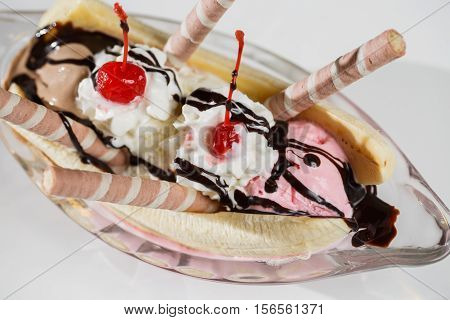 Banana split, banana and ice cream dessert with toppings