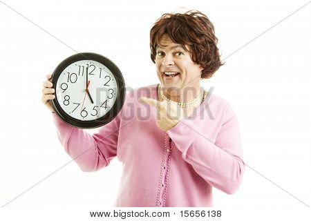 Cross dresser pointing to a clock that reads almost five o'clock.  Isolated on white.