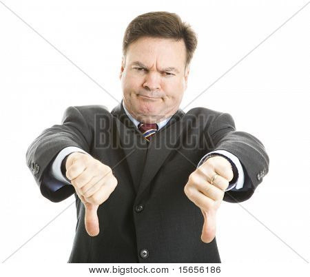Businessman frowning and giving two thumbs down.  Isolated on white.
