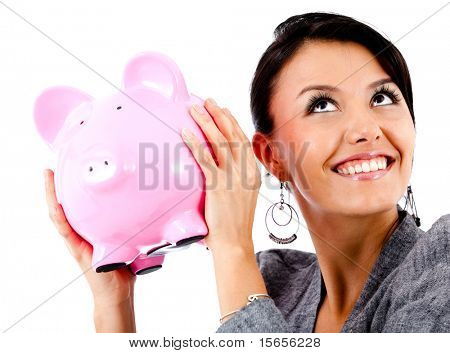 Happy Woman with ihre Ersparnisse in ein Sparschwein - isoliert