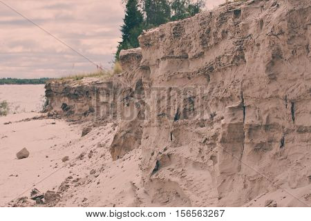 The dramatic steep sandy beach on the river. swallows' nests.