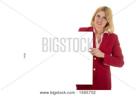Female Executive In Red Holding Invisible Sign