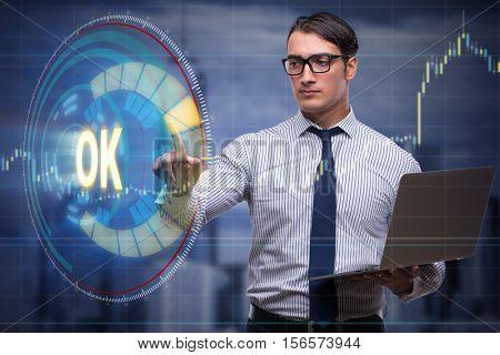 Businessman pressing virtual button OK