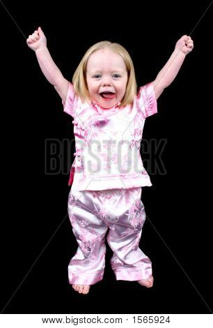 Cute Little Girl With Her Hands Raised In The Air