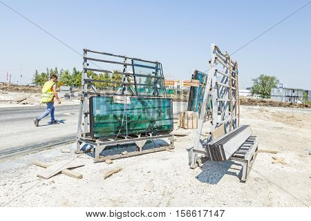 Pallet with thermo window glasses in construction site waiting for built in. Double glazed glass window stacked and ready for build in.