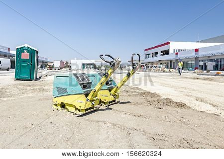 View on construction site with machinery people at work. Landscape transform into large urban area.