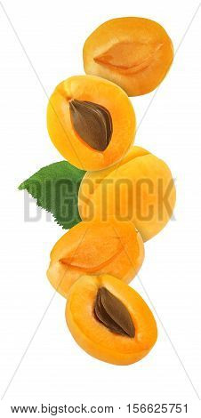 hanging falling hovering and flying whole and sliced apricot isolated on white background with clipping path