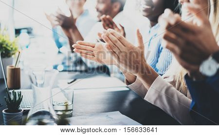 Close up view of business seminar listeners clapping hands. Professional education, work meeting, presentation or coaching concept.Horizontal, blurred background