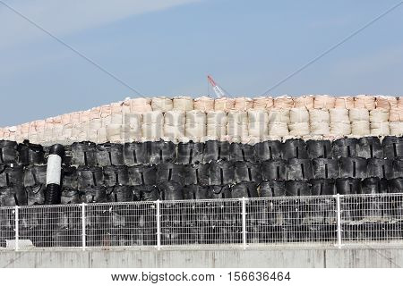 stack of toxic substance bag against a blue sky