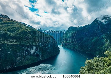 Inlet from the ocean to Geiranger fjord with steep mountain sides.