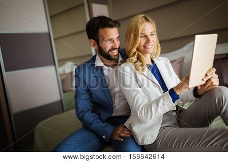 Business couple on business trip using tablet