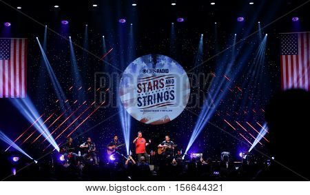 CHICAGO-NOV 9: Brantley Gilbert, Joe Don Rooney, Gary LeVox & Jay DeMarcus of Rascal Flatts perform at CBS Radio's Stars & Stripes at the Chicago Theatre on November 9, 2016 in Chicago, Illinois.