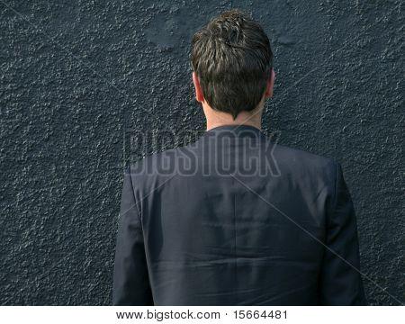man against a wall