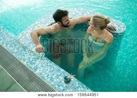 Couple enjoying bubble bath and modern hydrotherapy