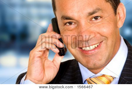 Business Man On The Phone In An Office