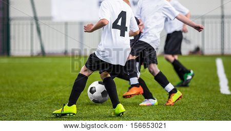 Kids play soccer football game. Football training session for youth team. Football academy practice