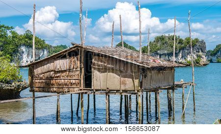 Local Bamboo Hut in Kabui Bay near Waigeo. West Papuan, Raja Ampat, Indonesia.