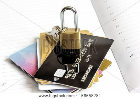 Credit cards with lock close up - online shopping on diary background