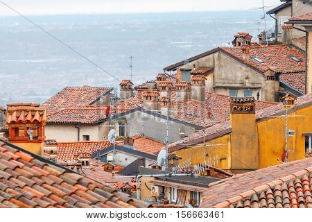 Scenic view of stone towers and tiled roofs in the old historic part of town. Bergamo. Italy.