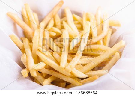 Golden French fries potatoes ready to be eaten. French fries.