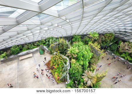 Singapore, Republic of Singapore - May 5, 2016: tourists exploring Cloud Garden conservatory greenhouse