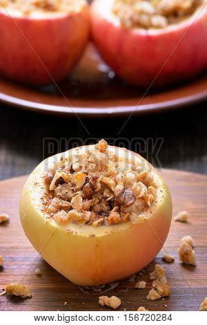 Baked apples stuffed with nut and honey close up view