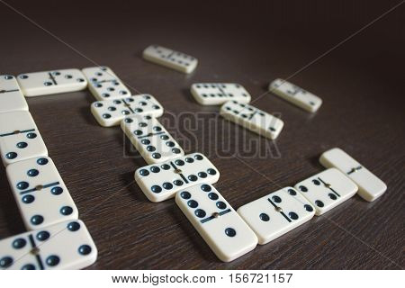 Dominoes on wooden table background. Entertainment. A game