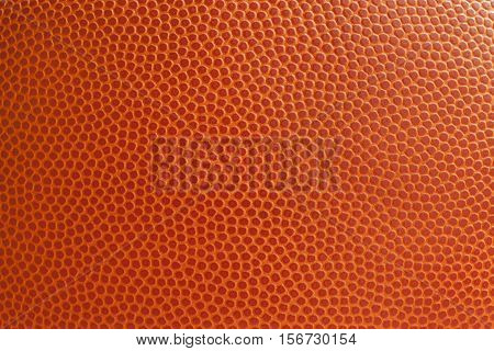 A close up view of a basketball texture