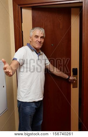 Man inviting to room in a hotel