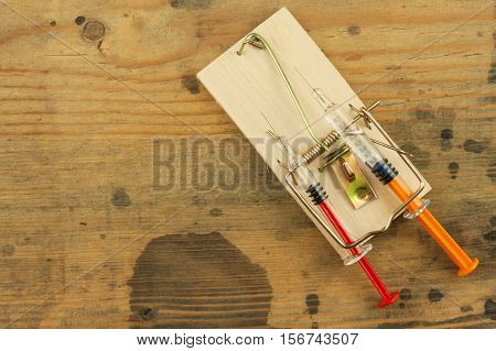 Mousetrap with drug. Drug addiction. Dangerous steroids.